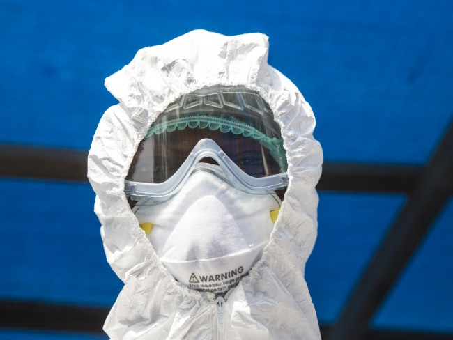 Photo of a man wearing Ebola PPE
