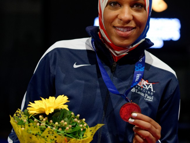 photo of Ibtihaj Muhammad wearing a red white and blue headscarf