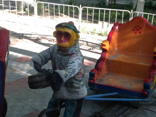 photo of a creepy fiberglass monkey from a carnival